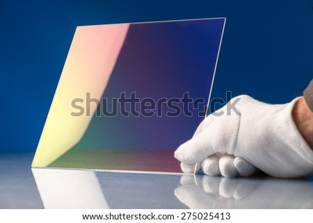 Chalcogenide glass used in a photonic integrated optical circuit (PIC) o is a device that integrates multiple photonic functions - stock photo