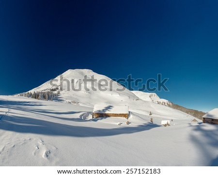 chalet in the mountains, sunny - stock photo