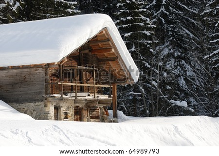 chalet under the snow - stock photo