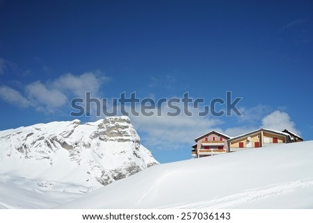 Chalets on Skiing Slope in the Alps in Fruit, Switzerland - stock photo