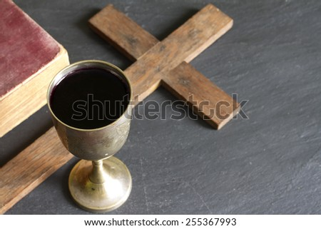Chalice of wine bible and cross easter religion concept - stock photo