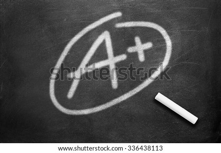 Chalk and grade a plus write on chalkboard background - stock photo