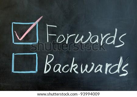 Chalk drawing - Forwards or backwards - stock photo