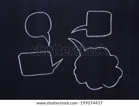 Chalk drawing - Various speech bubbles on blackboard  - stock photo