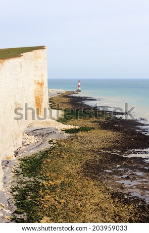 Chalk headland and lighthouse at Beachy Head in Southern England - stock photo
