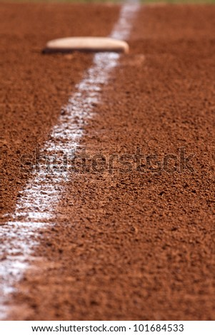 Chalk Line to First Base; focus on chalk line with base in background - stock photo