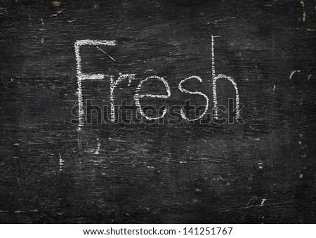 Chalk on black board: Fresh - stock photo