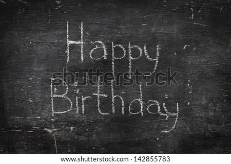 Chalk on black board: Happy birthday - stock photo