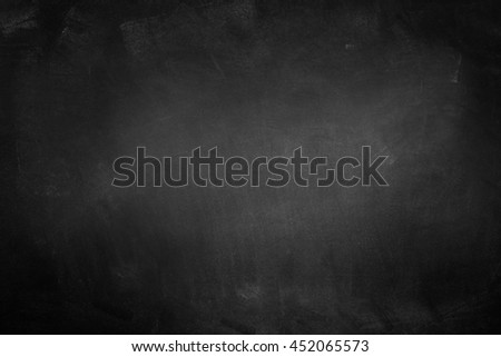 Chalk rubbed out on blackboard background - stock photo