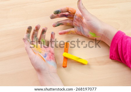 chalk stained hands - stock photo