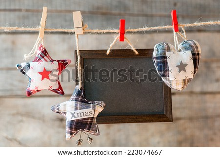 Chalkboard attach to rope. Chalkboard attach to rope, textile heart and stars  - stock photo
