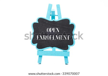 Chalkboard in blue wooden frame isolated on white background with open enrollment words - stock photo