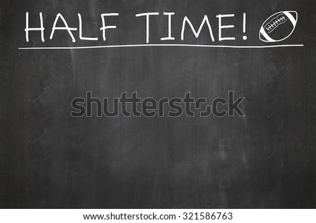 Chalkboard with half time and football - room for copy - stock photo