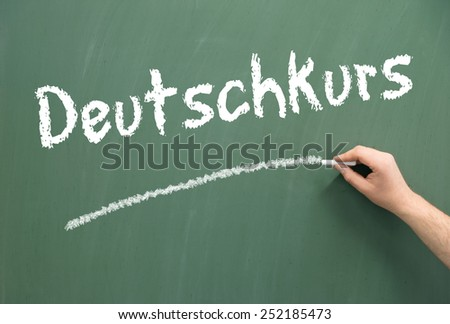 Chalkboard with the german words German Course / german course - stock photo