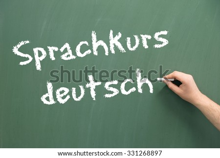 Chalkboard with the word language course german / German language course - stock photo