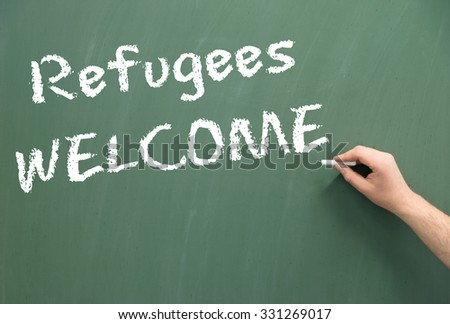 Chalkboard with the words Refugees Welcome / Refugees Welcome - stock photo
