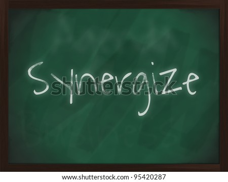 Chalkboard with wooden frame and the text synergize - stock photo
