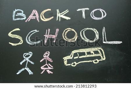 chalkboard writing back to school  - stock photo