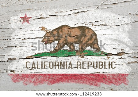 Chalky american state of california flag precisely painted with color chalk on grunge wooden texture - stock photo