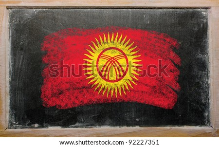 Chalky kyrghyzstan flag painted with color chalk on old blackboard - stock photo