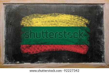 Chalky lithuanian flag painted with color chalk on old blackboard - stock photo