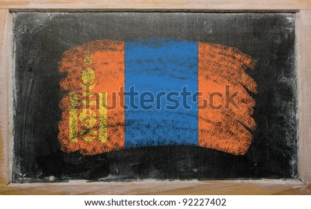 Chalky mongolian flag painted with color chalk on old blackboard - stock photo