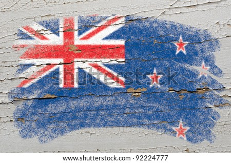 Chalky new zealand flag painted with color chalk on grunge wooden texture - stock photo