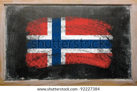 Chalky norwegian flag painted with color chalk on old blackboard - stock photo