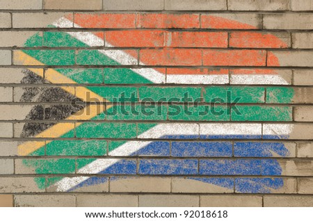 Chalky  south african republic flag painted with color chalk on grunge old brick wall - stock photo