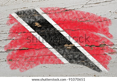 Chalky trinidad and tobago flag painted with color chalk on grunge wooden texture - stock photo