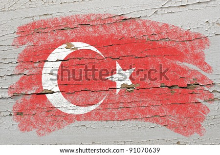 Chalky turkish flag painted with color chalk on grunge wooden texture - stock photo