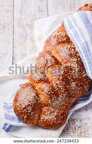 Challah bread with sesame seeds. Pastry,flour and sesame seeds.selective focus - stock photo