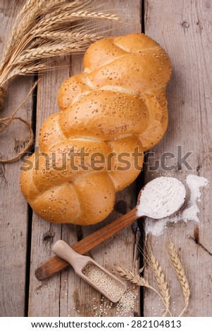 Challah bread with sesame seeds. Pastry,flour and sesame seeds.selective focus.Copy space. - stock photo