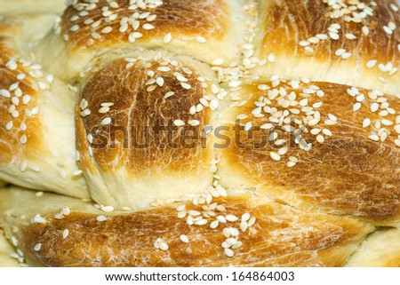 Challah is a special Jewish braided bread eaten on Sabbath and holidays. - stock photo