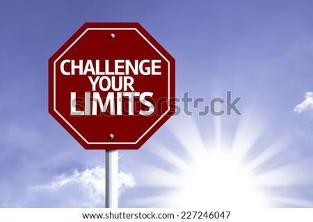 Challenge your Limits written on red road sign with a sky on background - stock photo