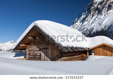 Challet and Sella ronda mountain, Dolomites, Italy - stock photo