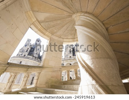 CHAMBORD, FRANCE - SEPTEMBER 25, 2011: Detail of an original staircase from Chambord castle, it was built in the 16th century and is one of the most recognizable castles in the world. wide view photo  - stock photo