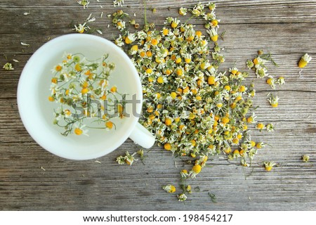Chamomile tea Chamomile tea on the wooden table. - stock photo