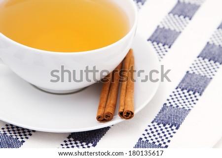 Chamomile tea with cinnamon sticks - stock photo