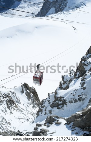 CHAMONIX, FRANCE - SEPTEMBER 02: Aiguille du Midi cable car. The cable car is the highest in Europe, and offers close views of the Mont Blanc summit. September 02, 2014 in Chamonix. - stock photo