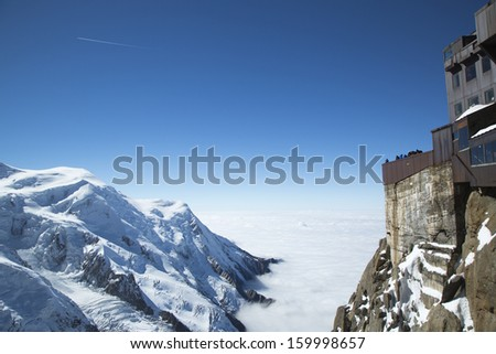 Chamonix terrace overlooking Mont Blanc massif at the mountain top station of the Aiguille du Midi (3842 m) in French Alps  - stock photo