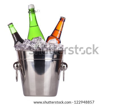 Champagne and beer bottles in ice bucket isolated on a white background - stock photo