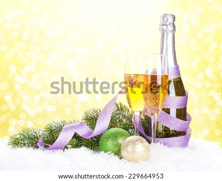 Champagne and christmas decor with snow bokeh background - stock photo