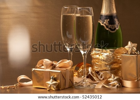 Champagne and gift - stock photo