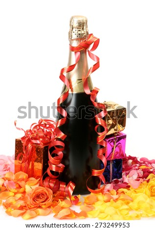 Champagne and rose petals - stock photo
