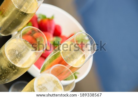 Champagne and strawberries - stock photo