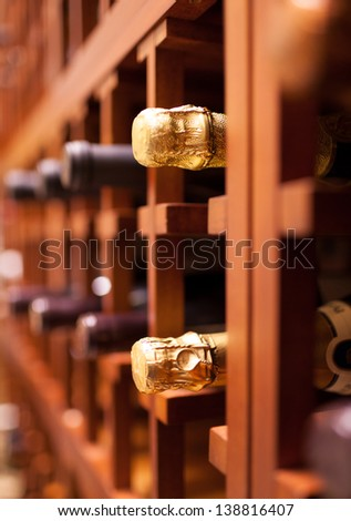 Champagne and wine bottles in the cellar - stock photo