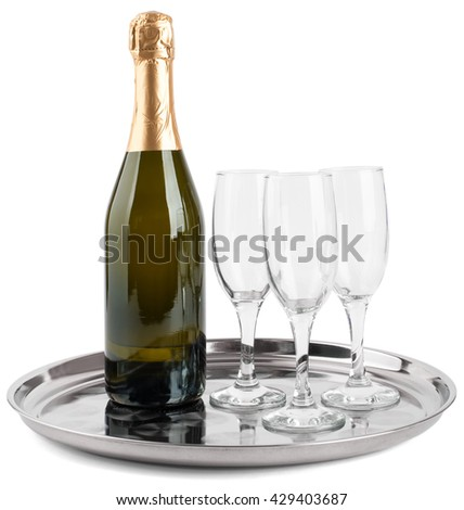Champagne bottle and three champagne glasses on tray isolated on white background - stock photo