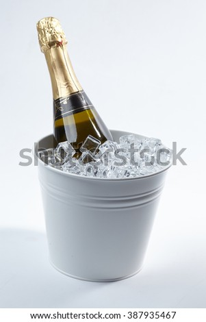 Champagne bottle in a bucket  - stock photo
