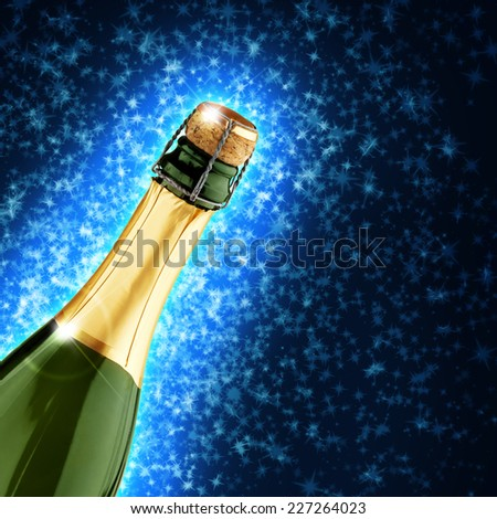 champagne bottle in a starry blue background - stock photo